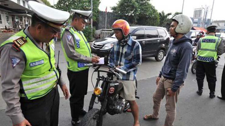 Menyuap Polisi Lalu Lintas